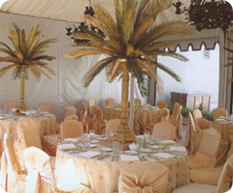 Tented Destinatiom Wedding Reception with palm tree centerpieces