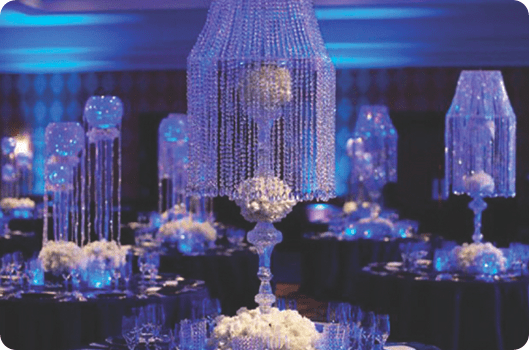 crystal shade centerpieces with blue lighting wedding reception