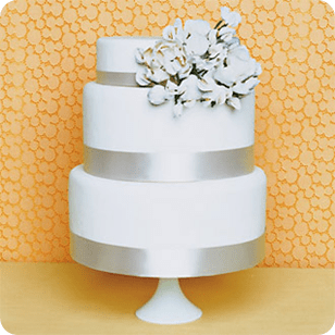 Round Three tier wedding cake with silver ribbon and offset flowers