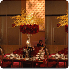 Tall Rose Centerpieces with orchids on rectangular tables