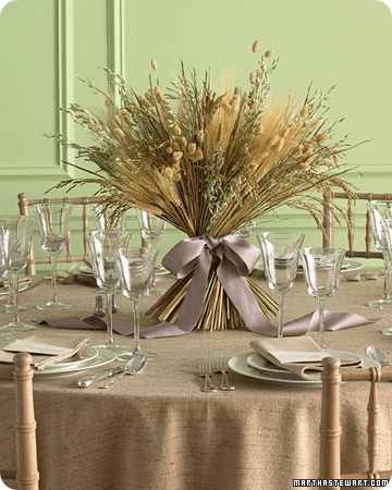 Bountiful dried grains and grasses tied with a large satin bow;