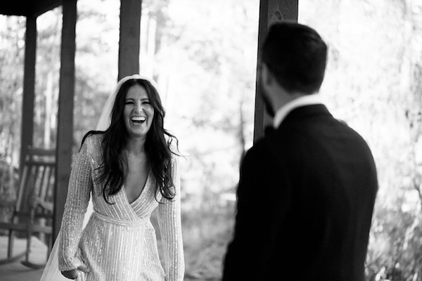 black and white photos of a happy bride laughing after seeing her groom