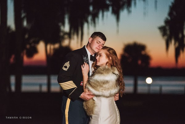 bride and groom at sunset at their wedding Crane Cottage Jekyll Island