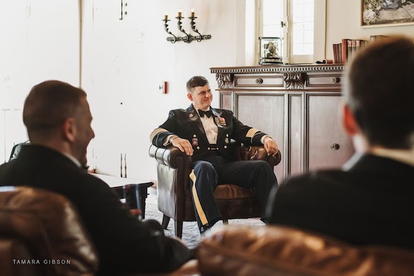 groom in his military dress uniform before seeing his bride