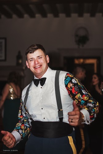 groom wearing a custom made Star Wars tuxedo shirt