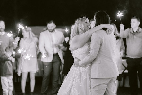 black and white wedding photo of two brides during their first dance