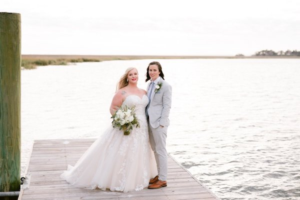 Two brides on the dock at Captain's Bluff along the Frederica River on Saint Simons Island