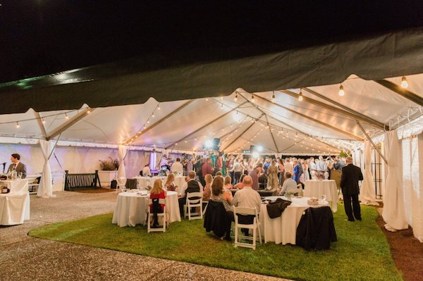 frame tent with dance floor and lounge area at Crane Cottage