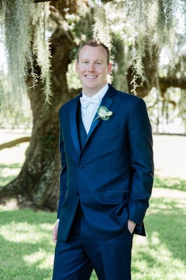 Groom wearing navy blue suit at Jekyll Club Hotel