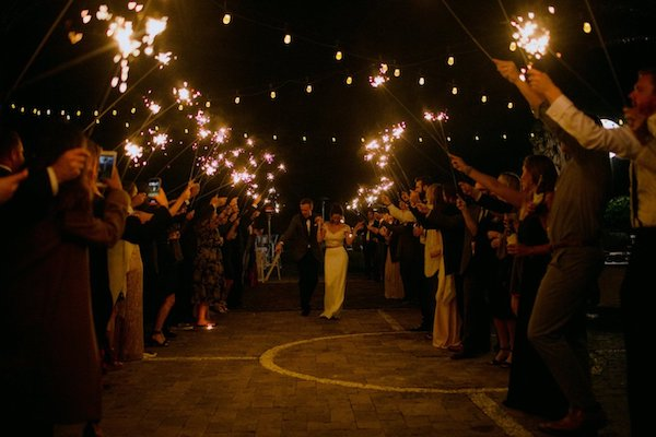 wedding guests sending newlyweds off under a shower of sparklers at the Westin Jekyll Island