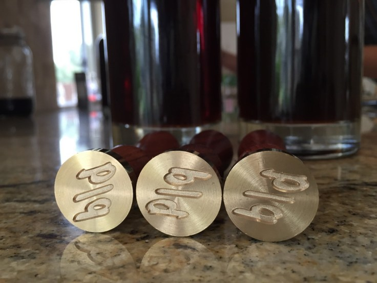 Wax seals with the Rational Spirits logo.