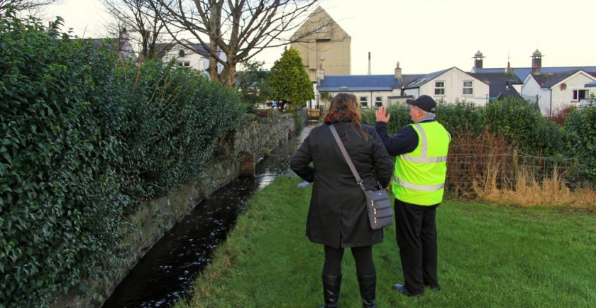 Mrs. Wonk and Eddie MacAffer examine the water supply, Bowmore distillery