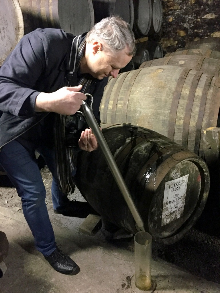 Cocktail Wonk pulling some fifty year Lagavulin from a cask at the distillery