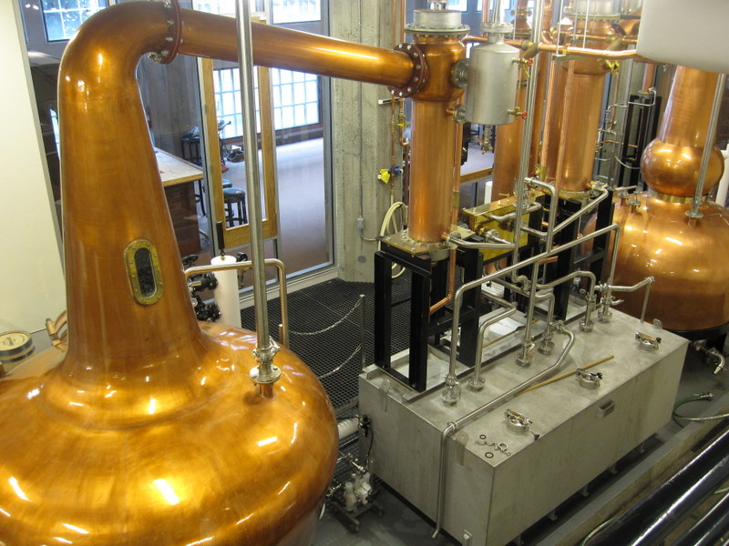 Pot stills at Copperworks Distillery, Seattle WA (photo via Copperworks)
