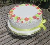 White party cake with sugar blossoms