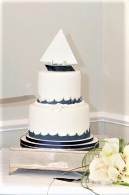 Nautical wedding cake with sugar boat