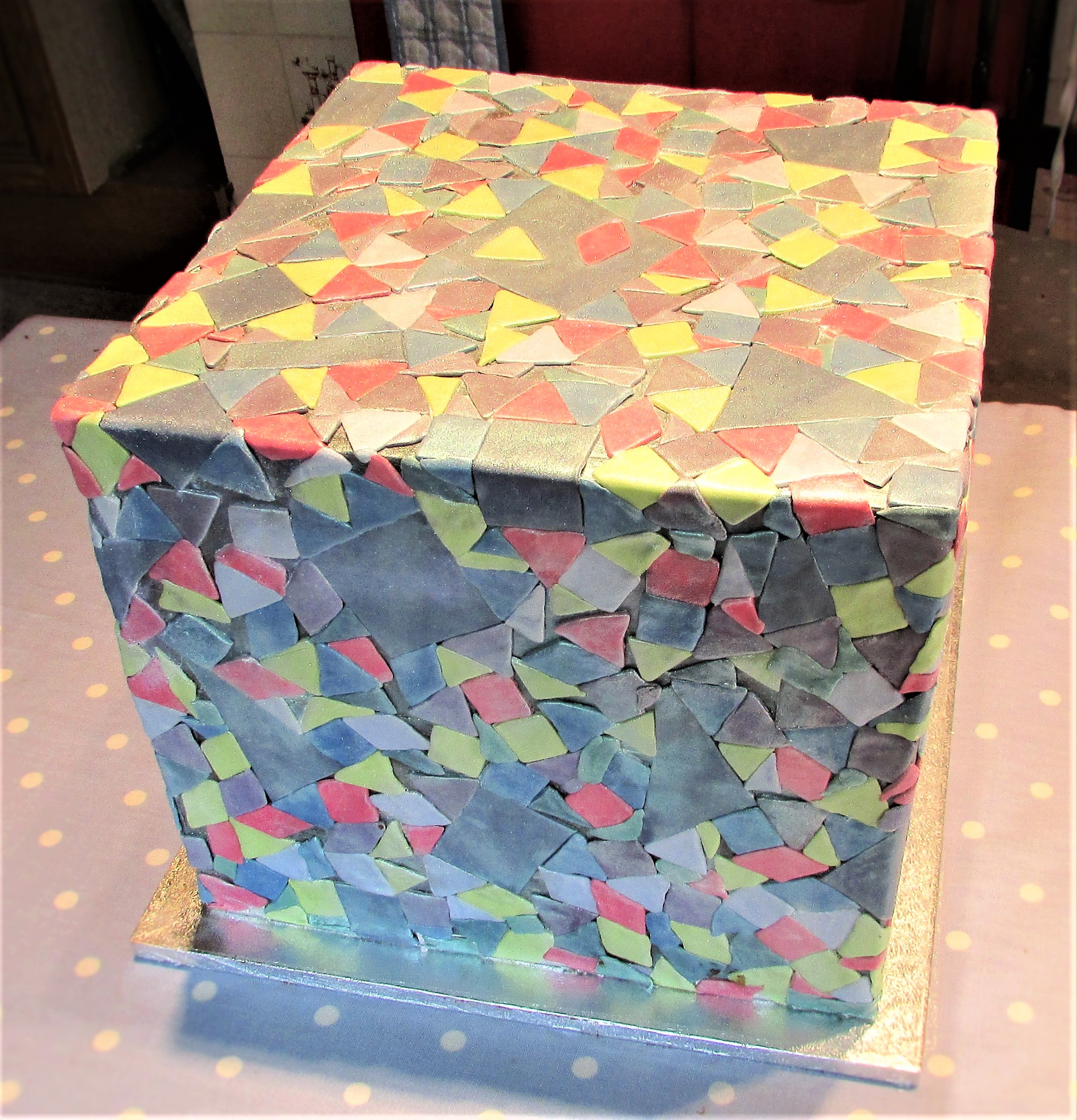 Cube shaped party cake with mosaic decoration