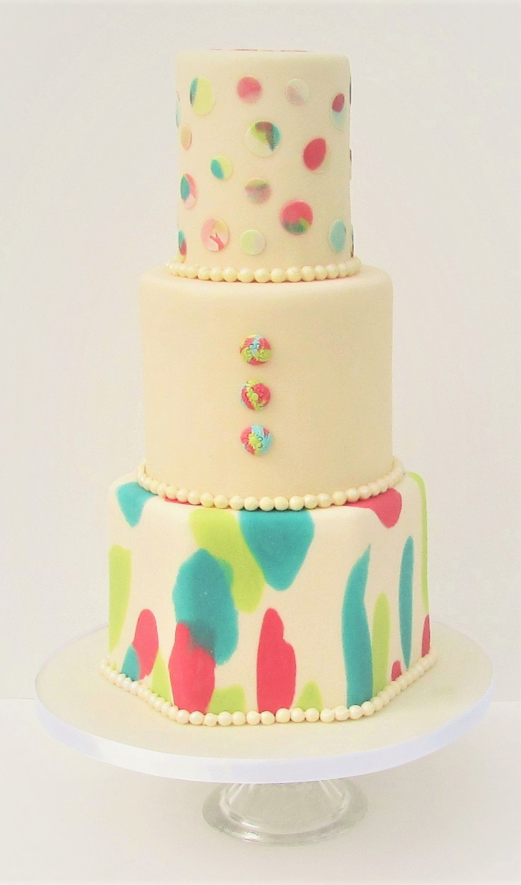 Cream wedding cake with coloured spots