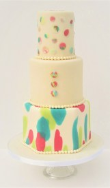 Cream & Pearl Wedding cake with Coloured Splashs & Sugar Bubbles & Buttons by Cocoa & Whey Cakes in Winchester