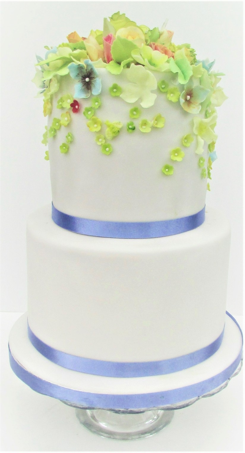 Summer Blossoms Wedding Cake with Sugar Blossoms by Cocoa & Whey Cakes in Winchester, Hampshire