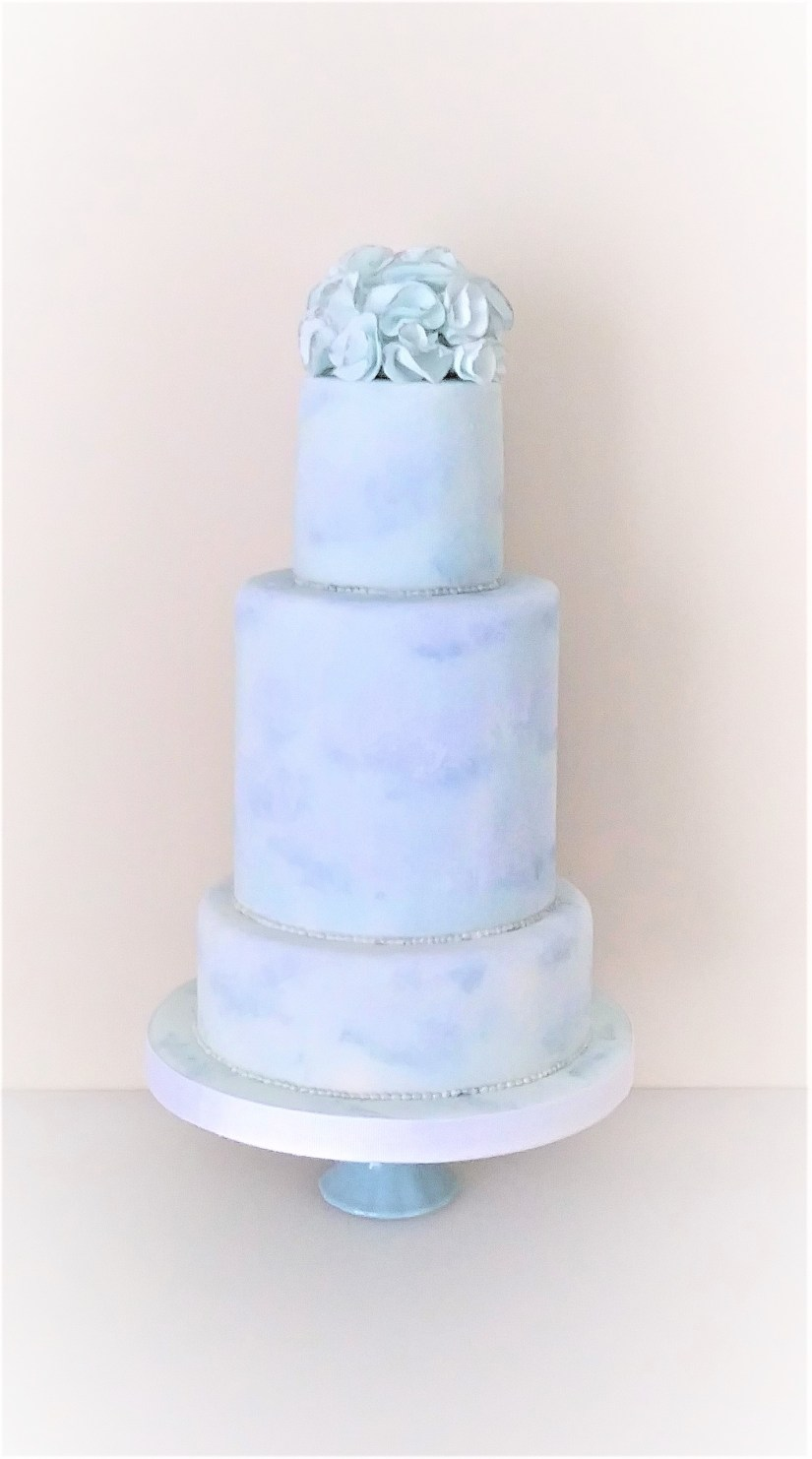 Blue Wedding Cake with Hand Painted Clouds & Sugar Ruffles by Cocoa & Whey Cakes in Winchester, Hampshire