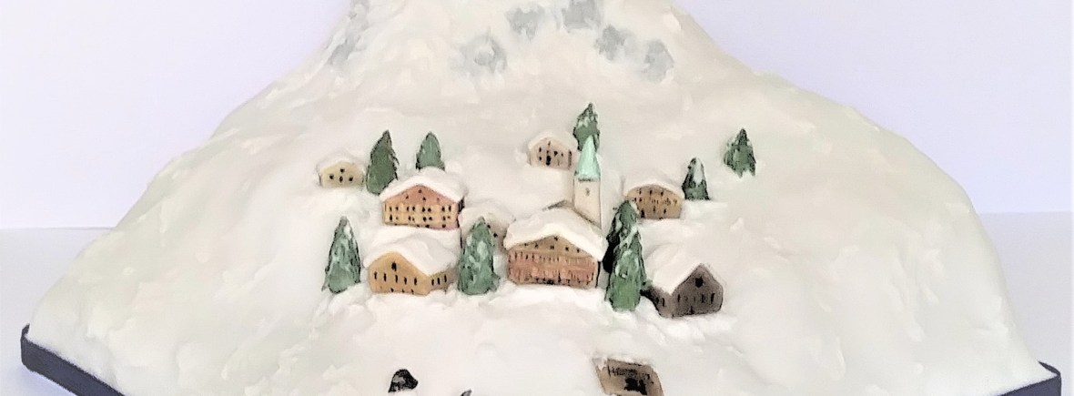 Alpine Snow Village Party Cake by Cocoa & Whey Cakes in Winchester, Hampshire