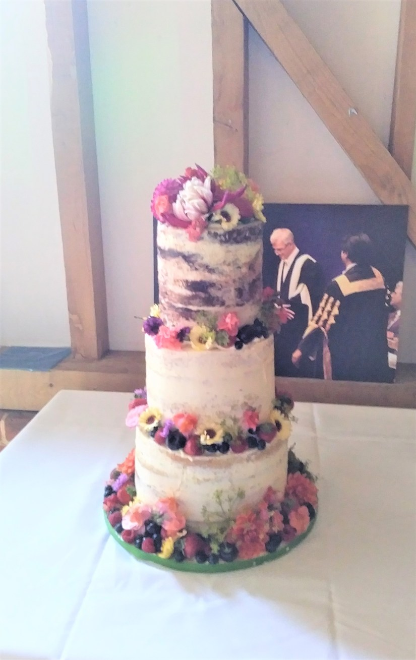 Semi-Naked Wedding Cake with Edible Flowers and Fruits by Cocoa & Whey Cakes in Winchester