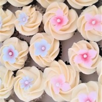 Mini Cupcakes decorated with a swirl of buttercream and sugar flowers