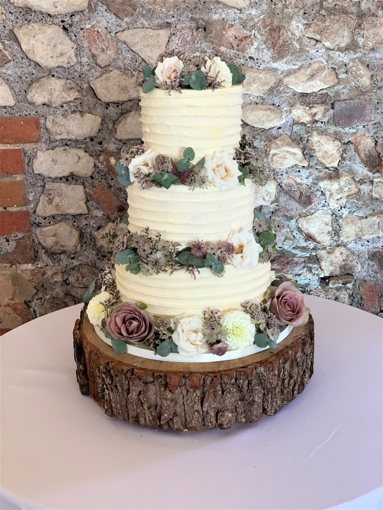 Buttercream Ruffles Wedding Cake with Fresh Flowers by Cocoa & Whey Cakes