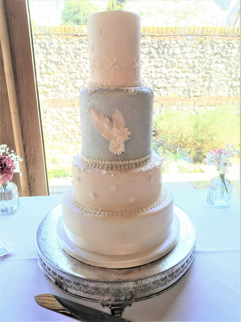 Blue & Ivory Feather & Lace Wedding Cake by Cocoa & Whey Cakes