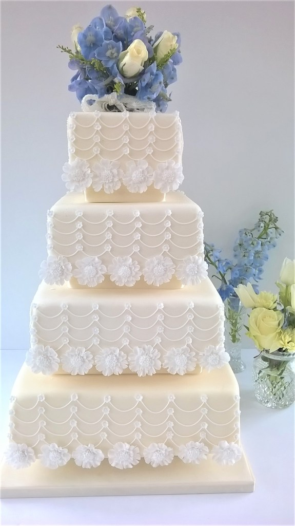Cream & White Flower & Swag Wedding Cake by Cocoa & Whey Cakes