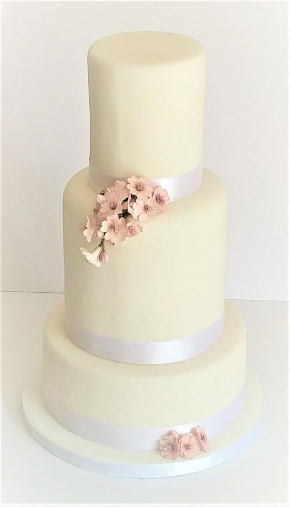 Semi-Naked Wedding Cake with Summer Fruits & Avalanche Roses