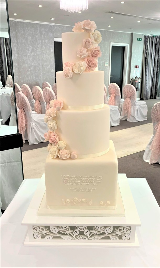 Ivory & Pink Sugar Cascade Wedding Cake with Chaucerian Text by Cocoa & Whey Cakes in Dorset