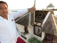 Coco Bodu Hithi Housekeeping Manager Anup proudly showing the winning Island Villa miniature