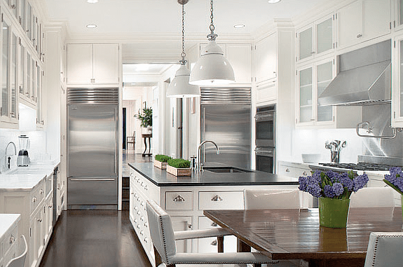 White Eat In Kitchen Designed By Peter Pennoyer With Stainless Appliances