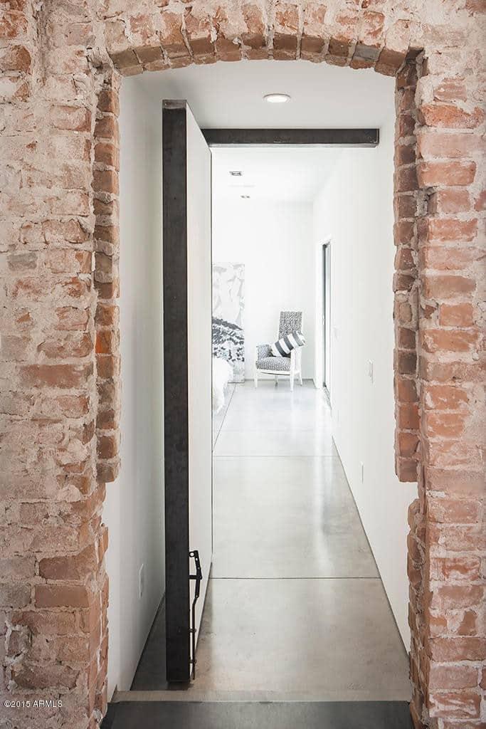 modern  home doorway exposed brick walls cococozy