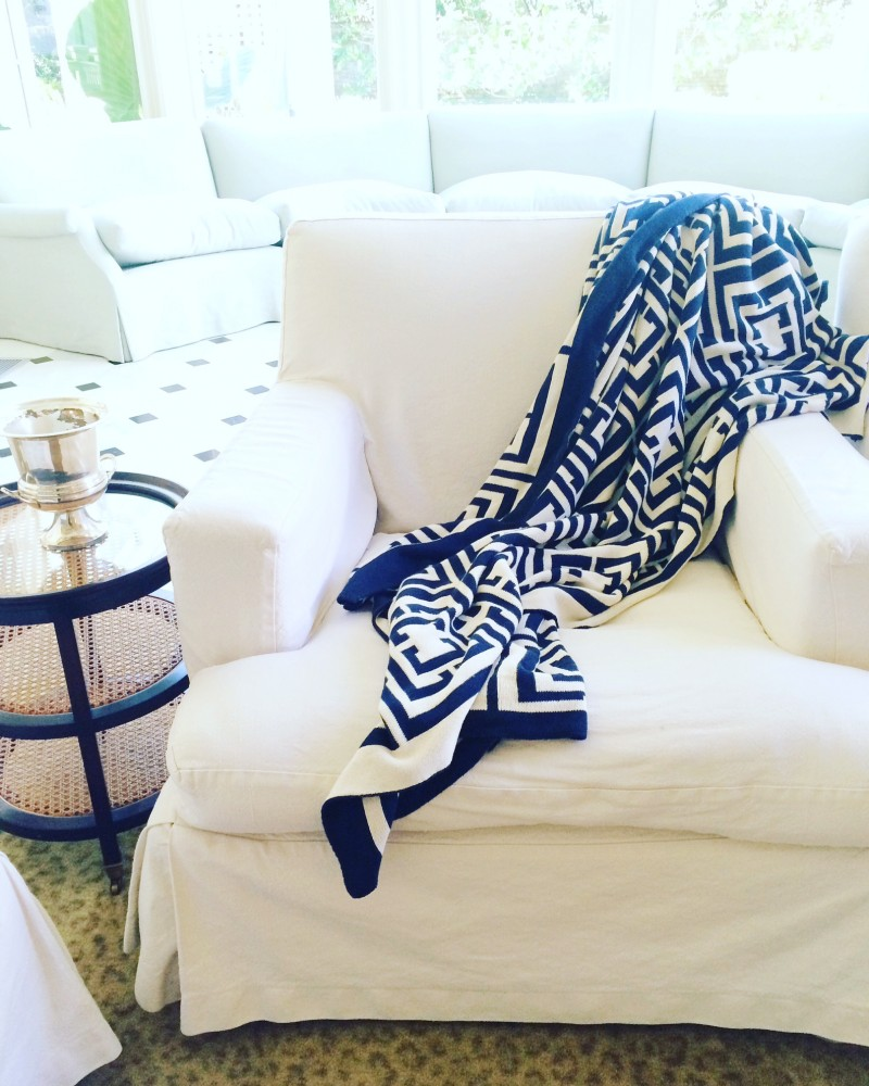 Navy Blue COCOCOZY Logo Throw on White Chair