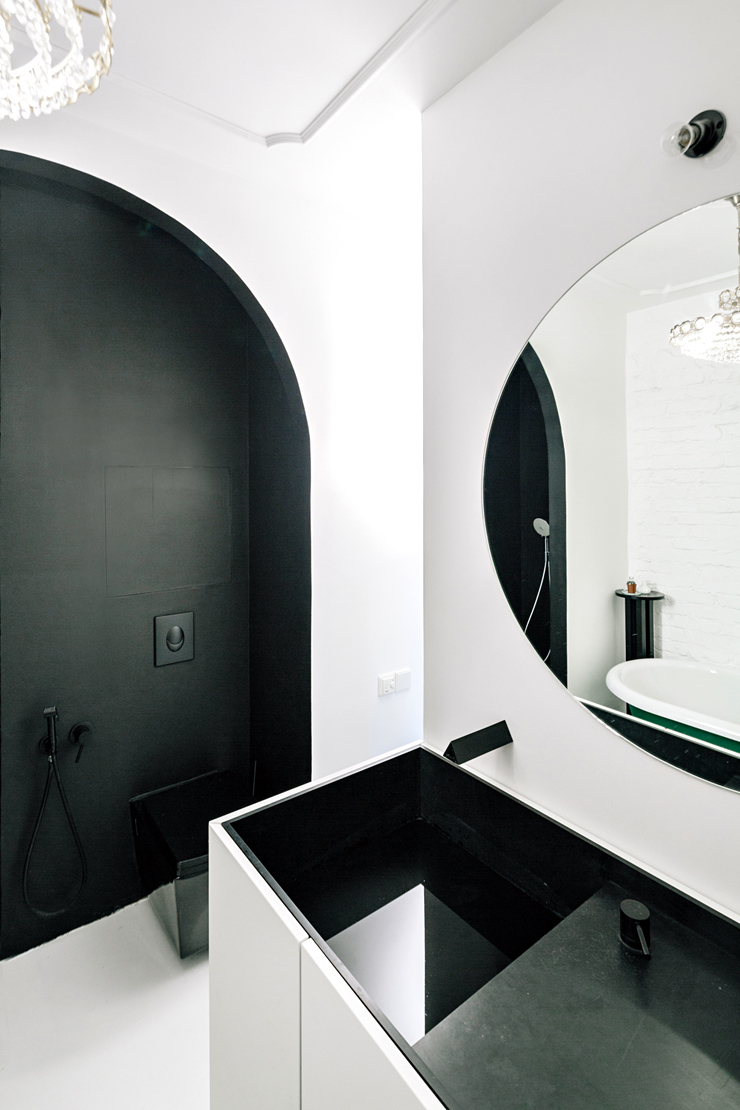 Color block bathroom black arch shower wall