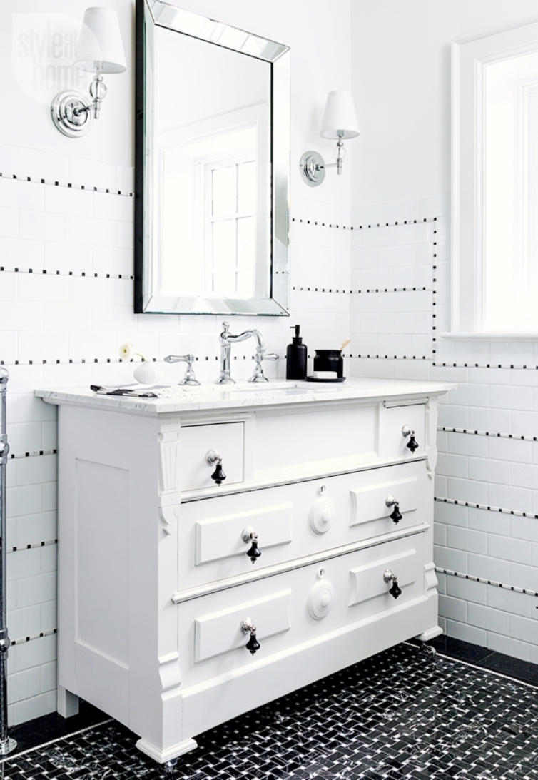 white-on-black-bathroom-white-vanity-black-basketweave-tile-floor-cococozy-styleathome