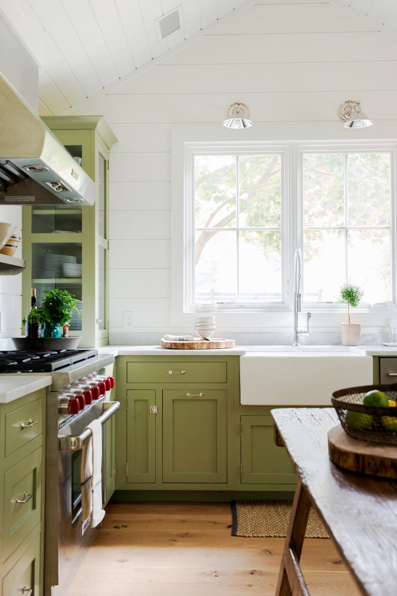 farmhouse kitchen green cabinets shiplap walls