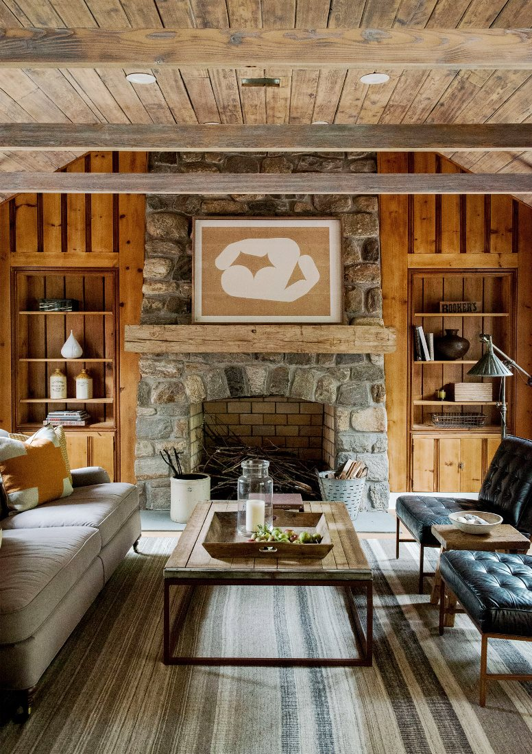 rustic farmhouse restoration living room stone fireplace exposed beam ceiling