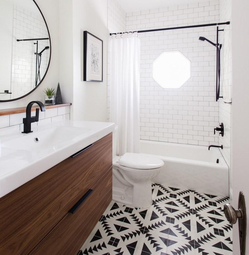 bright white bathroom round mirror dark faucet tiled floor
