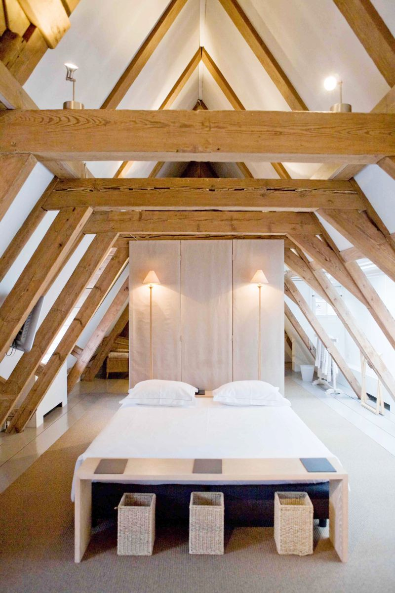 Exposed Beam bedrooms Aframe ceiling bedroom bright white bedding
