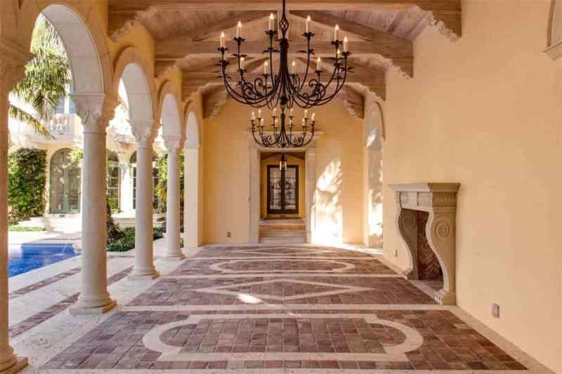 Palm Beach Estate Backyard Iron Chandelier Fireplace