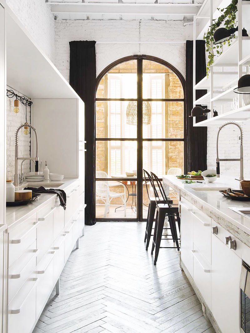 bright barcelona apartment galley kitchen arched windows