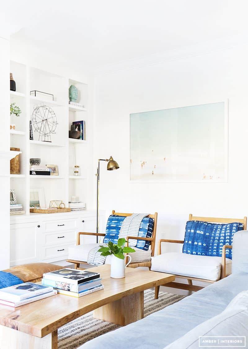 built in bookshelves living room accents bright white bookshelves wooden coffee table amber interiors