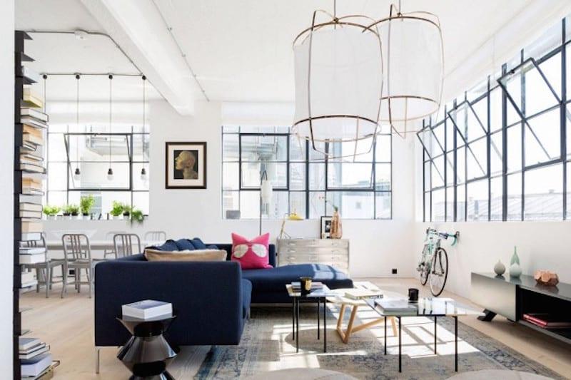 london loft navy sofa lantern chandelier bright white walls