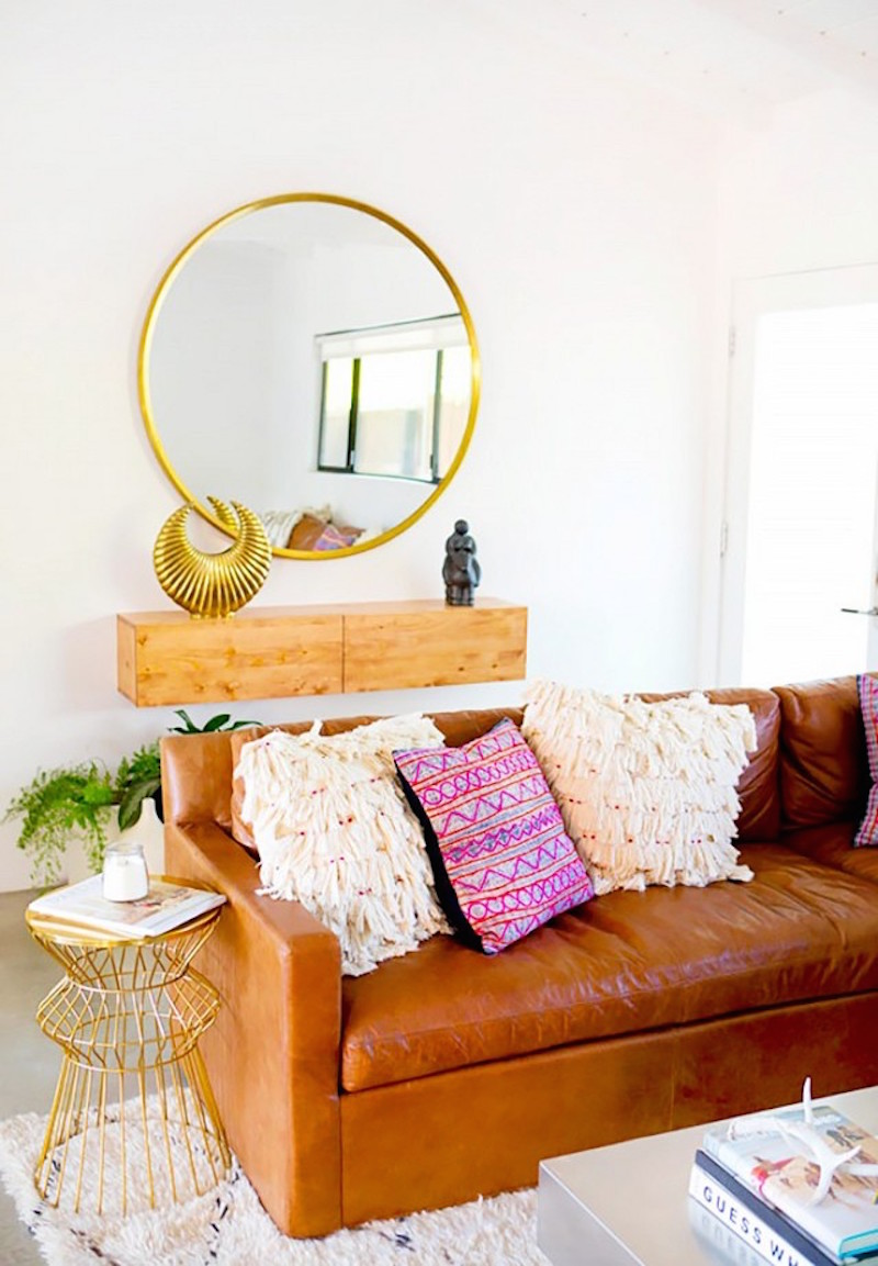 camel colored sofa gold mirror gold target side table