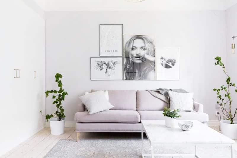Compact Quarters Living Room Lavender Sofa Grey Rug Wood Floors Gallery Wall
