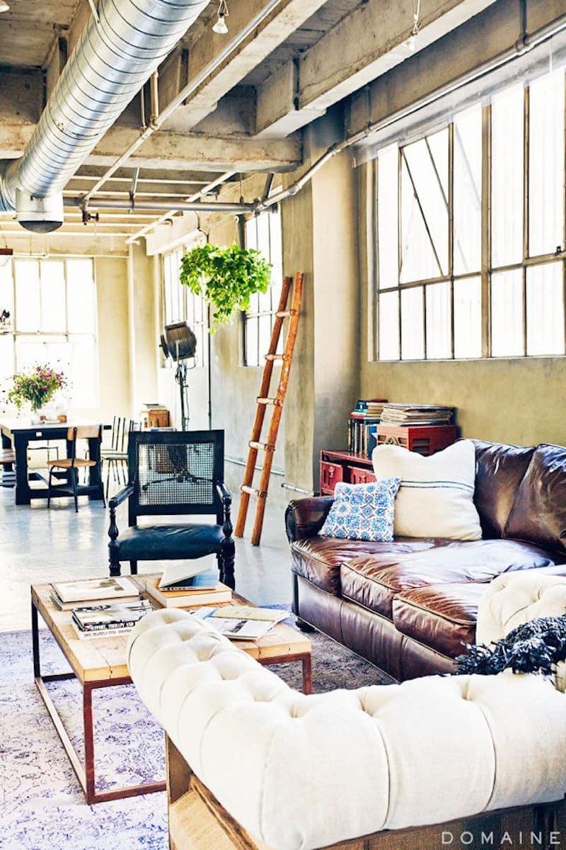 lovely loft industrial tufted sofa concrete floors